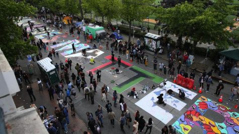 June 11, 2020, Seattle, Washington, USA: Artist paint a street wide sign that says Black Lives Matter over several blocks in what they call the Capitol Hill Autonomous Zone, nicknamed the CHAZ, in Seattle, Washington on June 11, 2020. This area around the Seattle Police Department
