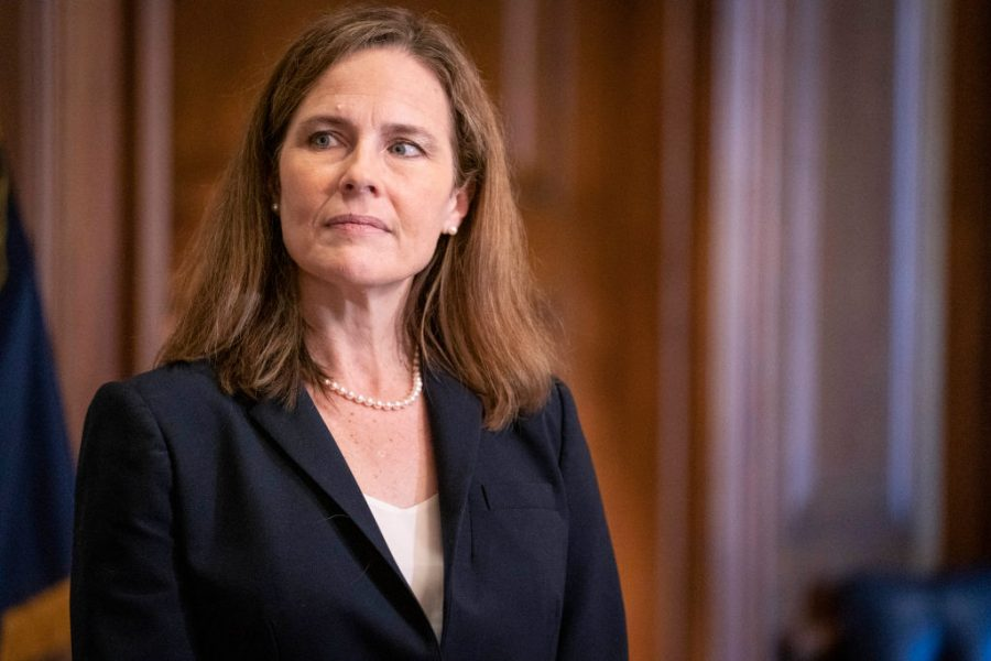WASHINGTON, DC - OCTOBER 21: Supreme Court nominee Judge Amy Coney Barrett meets with U.S. Sen. James Lankford (R-OK) on October 21, 2020 in Washington, DC. President Donald Trump nominated Barrett to replace Justice Ruth Bader Ginsburg after her death. (Photo by Sarah Silbiger-Pool/Getty Images)