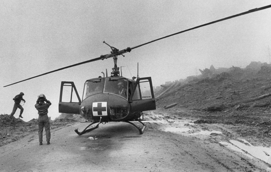 Members of a helicopter crew on a search and rescue mission look for survivors after the eruption of Mount St. Helens. (Barry Wong / The Seattle Times 1980)