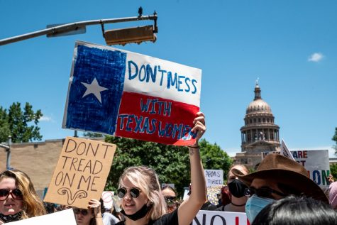 Texas protesters marching down Congress Ave, outside the state capitol. (Sergio Flores, Rolling Stones)