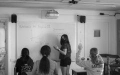 Gabi G. '24 leading a physics brainstorm. (Angelique G. '24)