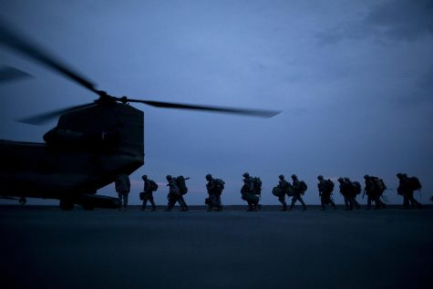 US Soldiers mount a transport helicopter back home. (Damon Winter, NYT)